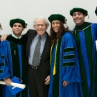 Murray Ettinger surrounded by medical school graduates.