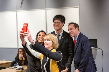 mRehab team members Sutanuka Bhattacharjya and Chen Song take a selfie with SUNY Chancellor Kristina Johnson and New York State Health Commissioner Howard Zucker.