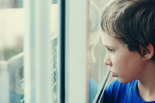 child looking out a window.