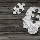 illustration of Alzheimer's disease featuring a human head with a puzzle piece missing