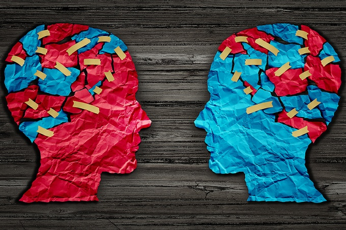 Silhouettes of two heads, one red and one blue, photo-illustration of political differences.
