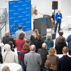 Bronwyn Keenan at the podium during the meet-and-greet reception in the Center for the Arts atrium.
