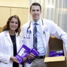 Pharmacy students holding drug disposal pouches.