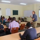 Gene Morse in a classroom leading a grant-writing workshop for University of Zimbabwe faculty.