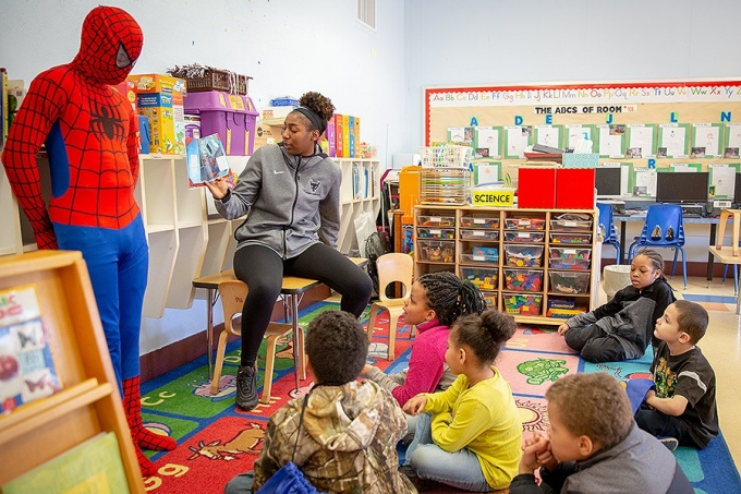 Members of the UB Women's Basketball team volunteer through the Bulls in the Community program at Marva J. Daniel Futures Preparatory School in downtown Buffalo, NY in April 2019.