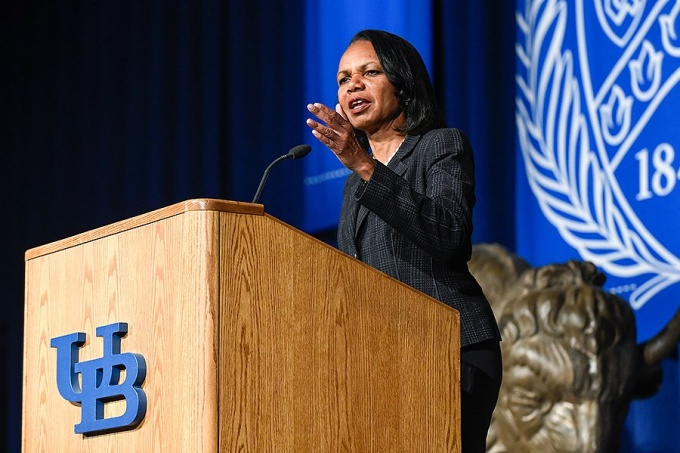 Condoleezza Rice stands at a podium as she delivers her Distinguished Speakers Series remarks.