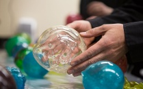 Student holds what appears to be a large bubble at a workshop by artist Zbigniew Oksiuta held at the Coalesce: Center for Biological Arts.