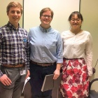 Medical student Thomas Listopadzi poses with UB School of Law student attorneys Colleen Roberts and Keyi Yang in an exam room at the Lighthouse Clinic.