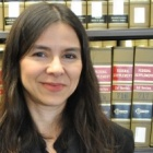 Samantha Barbas photographed in front of a shelf of law books.