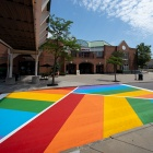 Rainbow crosswalk across Putnam Way looking from the Student Union toward UB Commons.