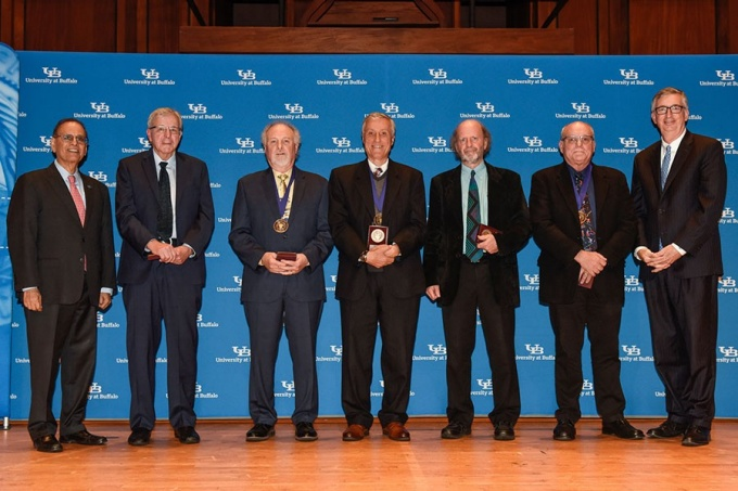 President Satish K. Tripathi and Interim Provost A. Scott Weber flank SUNY Distinguished Professors John Richard, Anthony Campagnari, Gary Giovino, Michel Bruneau and Errol Meidinger.
