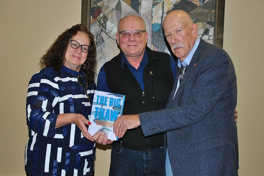 "From left, Kim Diana Connolly, Errol Meidinger and Ezra B.W. Zubrow, editors of ""The Big Thaw"" pictured together holding the book. ."