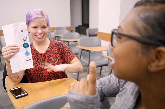 American studies instructor Jodi Maracle working with a Native language student.