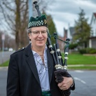 Dan Ryan, director of veteran services, has begun playing his bagpipes throughout his neighborhood to help raise his neighbors' spirits.