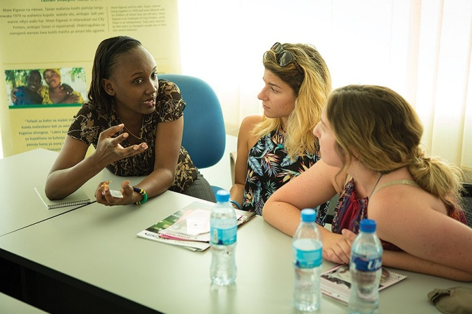 Students talk with an official from the Children's Dignity Forum about the organization's mission to empower girls by educating families about the damaging effects of early marriage and female genital mutilation.