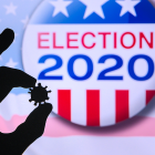 Hand silhouette holding COVID-19 virus; logo of USA presidential Election 2020 in background; concept of elections affected by pandemic.