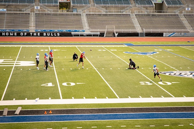 """UB football team members practice together in small """"pods.""""."""