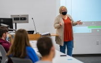 Cindi Tysick teaches a class while wearing a mask.