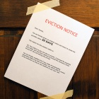 Eviction notice taped to a door.