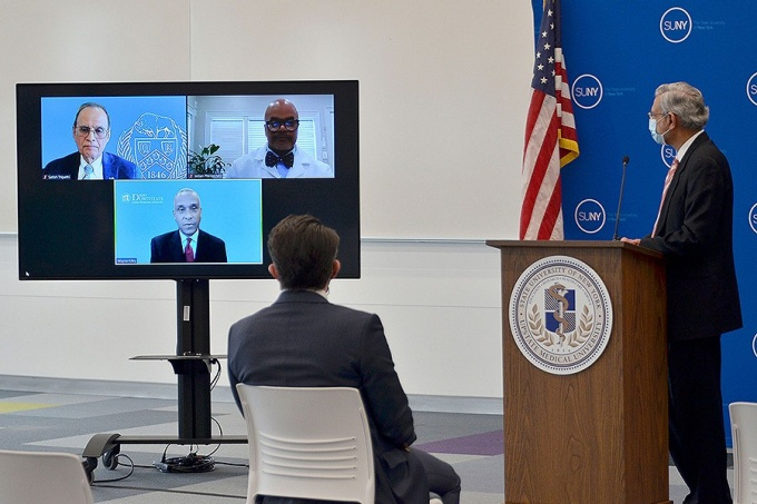 UB President Satish K. Tripathi on a monitor with the presidents of two other SUNY medical schools at an announcement of the new SUNY Pre-OP program at Upstate Medical univeristy.
