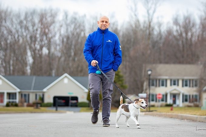 Tim Tryjankowski walking his dog through his neighborhood.