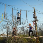 Students on the ropes course at the Jewish Community Center in Amherst as part of the class Theories and Techniques of Coaching through the Millard Fillmore College.