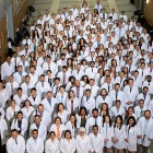 New residents pose together after receiving their white coats on June 26.
