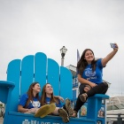 Some UB Students pose together for a selfie while enjoying Canalside.