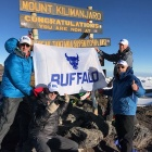 "A. Scott Weber and friends (all wearing ""Boldly Buffalo"" hats, summited Mount Kilimanjaro."