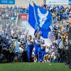 Members of the Spirit Team run onto the field with a flag featuring the UB bull before the game against Army on September 28.
