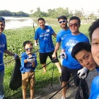 Members of the UB Alumni chapter in Penang, Malaysia, are shown taking a break from cleaning up a nearby river during the Alumni Day of Service held on June 1.
