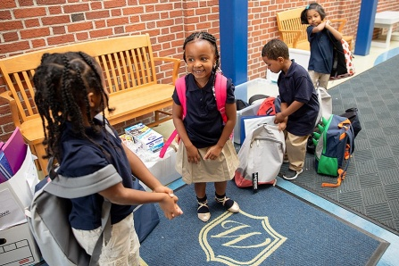Kindergartners from Westminster Community Charter School check out the new school supplies donated by members of the UB community.