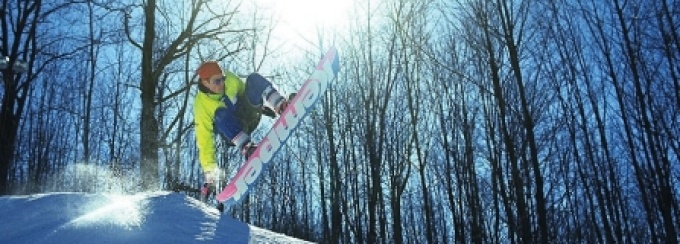 A snowboarder catching some air.