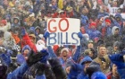 Excited fans at a Buffalo Bills game in the snow.