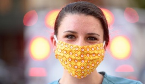 Woman wearing cloth face mask.