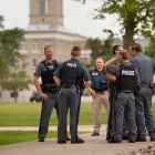 Police officers standing in circle on South Campus.
