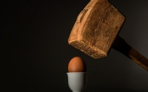 Egg with a hammer over it.
