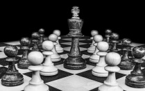 Black and white photo of chess board with the king piece in the center.