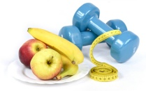 Apples, bananas, hand weights and a tape measure.