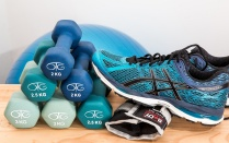 Dumbbells, sneakers and a medicine ball on a table.