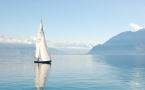 Sailboat on a calm lake.