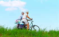 Elderly couple riding bikes.