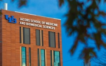UB Jacobs School of Medicine and Biomedical Sciences building exterior.