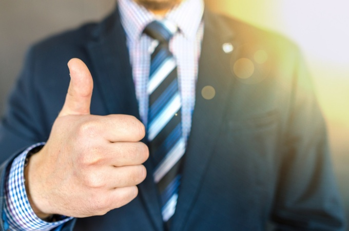 Businessman giving thumbs up.