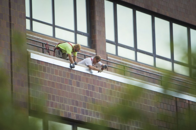 Workers flash brick at Capen Hall.