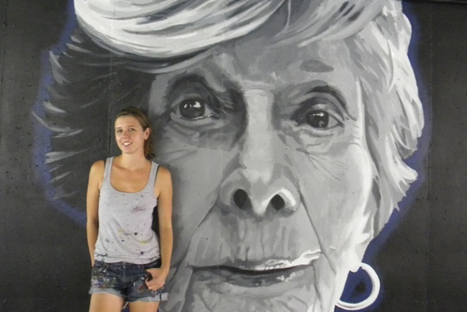 "Droze pictured with her 2012 mural, ""Morphos,"" in Indianapolis, Ind."