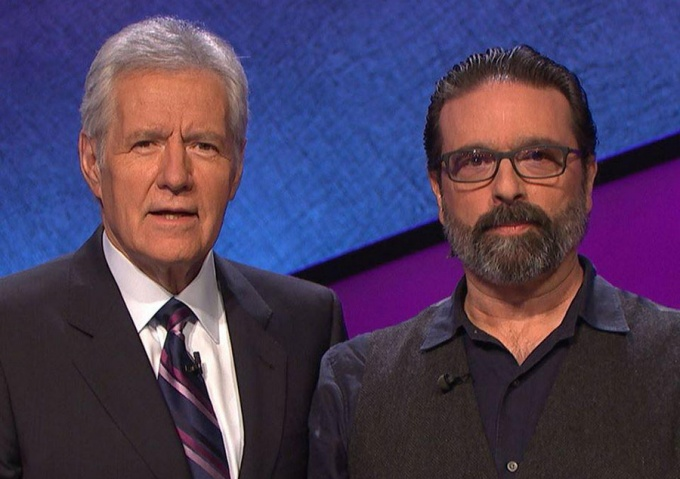 "Alex Trebek (left), host of ""Jeopardy,"" with recent contestant Edmund Cardoni (MA '85)."