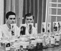The brothers of Alpha Phi Omega collect money in Norton Union Lobby. Image courtesy of University Archives