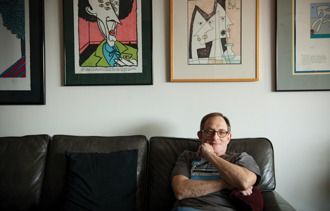 Marc Leeds in his Manhattan home, surrounded by artwork by Kurt Vonnegut Jr.