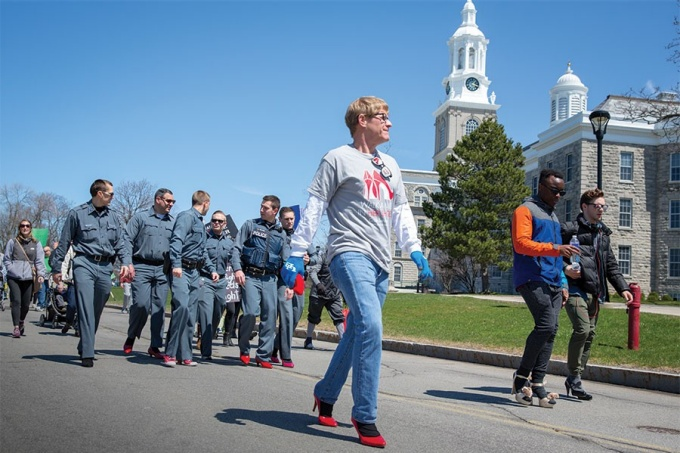 "University Police officers marching in ""Walk a Mile in Her Shoes"" rally."